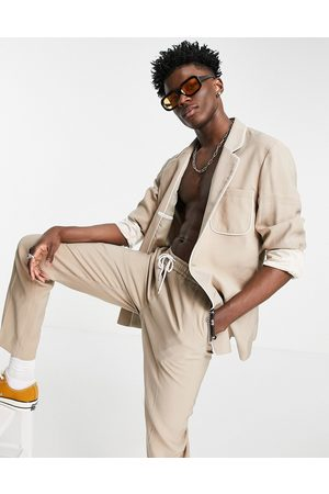 ASOS DESIGN Slim fit pyjama suit jacket with piping on pocket in camel-Neutral