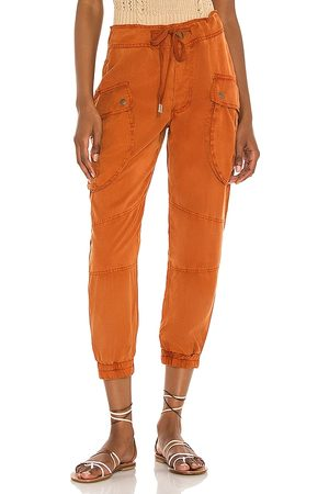 YFB CLOTHING Senhora Calças Cargo - Clyde Cargo Pant in - Rust. Size L (also in XS, S, M).