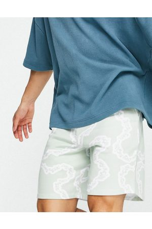 ASOS Homem Calções - ASOS Daysocial co-ord relaxed short with all over print in mint-Green