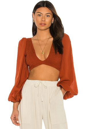 Indah Biru Solid Ruched Bodice Crop Top in - Brown. Size M/L (also in XS/S, S/M).