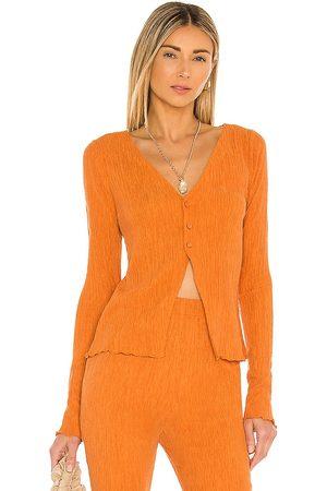 Camila Coelho Tais Long Sleeve Top in - Orange. Size L (also in XXS, XS, S, M, XL).