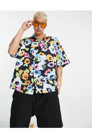 ASOS Boxy oversized revere shirt with all over bright floral-Black