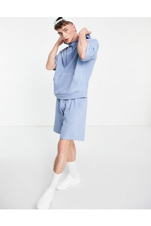 ASOS Homem Calções - Oversized tracksuit with short sleeve hoodie and shorts in washed blue