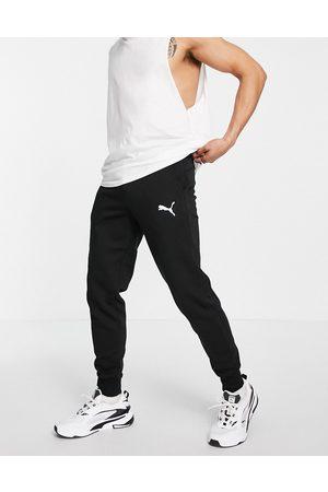 PUMA Homem Joggers - Essentials cat logo joggers in black