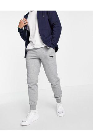 PUMA Homem Joggers - Essentials cat logo joggers in grey