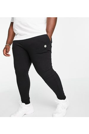 Le Breve Homem Joggers - Plus lounge co-ord joggers in black with white band