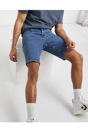 ASOS Stretch denim shorts in flat mid wash blue