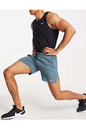 Nike Dri-FIT Flex Stride 7 inch shorts in blue