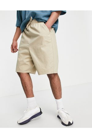 ASOS Drop crotch shorts with elasticated waist in beige-Neutral