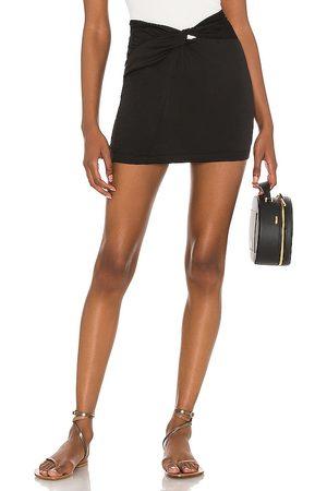 Free People Night Dreamer Twist Mini Skirt in - Black. Size 0 (also in 2, 4, 6, 8, 10, 12).