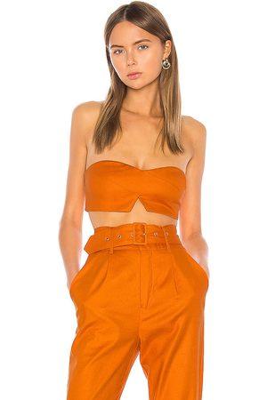 Camila Coelho Josephina Crop Top in - Burnt Orange. Size L (also in XXS, XS, S, M, XL).