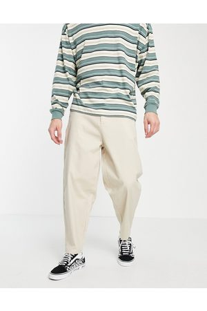 ASOS Homem Calças Chino - Oversized tapered chino trousers in beige-Neutral