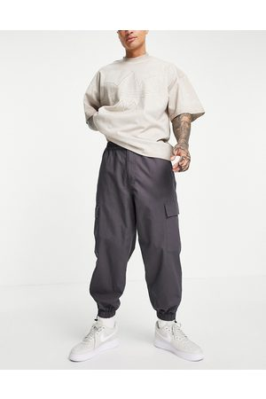 ASOS Oversized tapered cargo trousers with toggle hem in grey