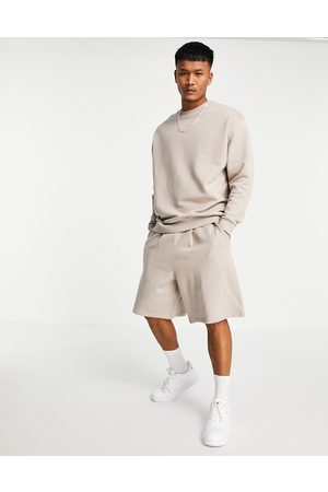 ASOS Tracksuit with oversized swesatshirt and smart jersey shorts in beige-Neutral