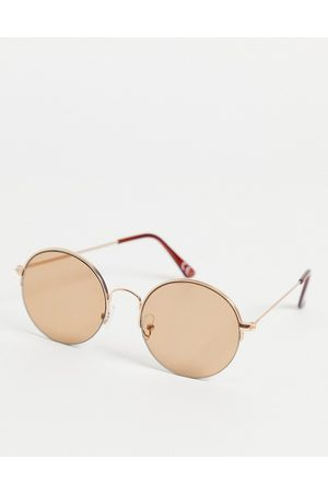 ASOS 70s round sunglasses in gold with light brown lens