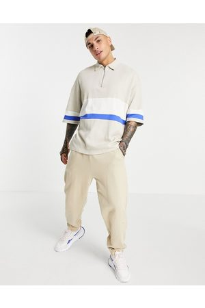 ASOS DESIGN Oversized polo shirt with half sleeves in beige rib-Neutral