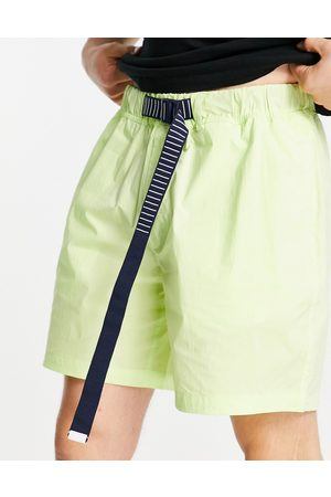 Tommy Hilfiger Belted beach shorts in faded lime green