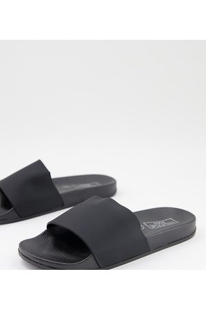 Truffle Collection Wide fit faux leather sliders in black