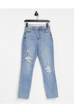 Hollister Knee rip boyfriend jeans in indigo wash-Blue