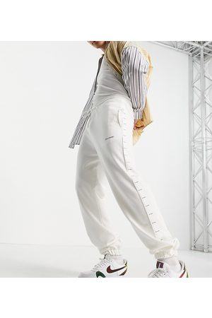 COLLUSION Oversized joggers with logo tape in ecru co-ord-White