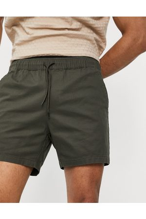 ASOS Skinny chino shorts with elastic waist in khaki-Green