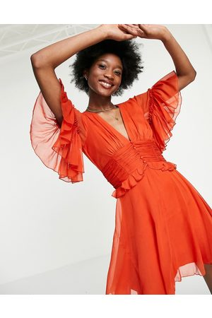 ASOS Flutter sleeve mini dress with pleated waist and button detail in rust-Red