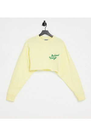 Reclaimed Vintage Inspired crop sweat with logo in yellow