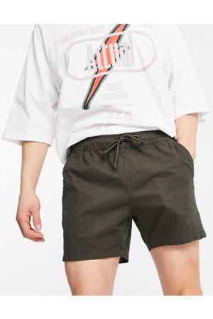ASOS Skinny chino shorts with elasticated waist in khaki-Green