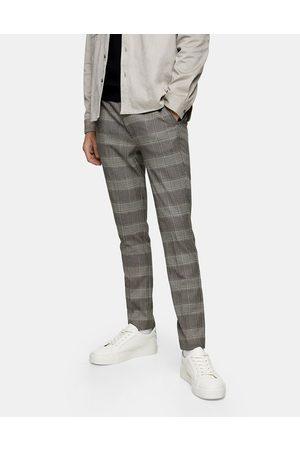 Topman Stretch skinny trousers in neutral check-Black
