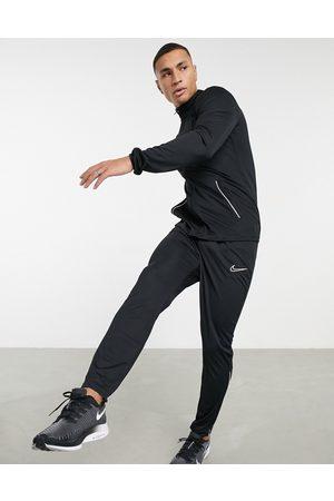 Nike Homem Calças Desportivas - Academy tracksuit in black and white