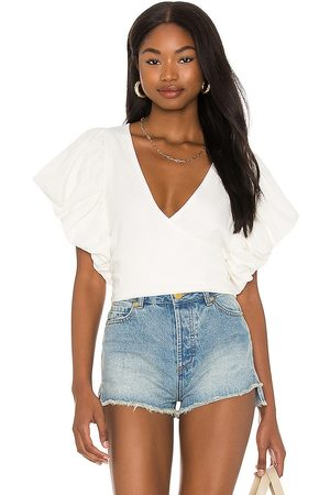 Free People Can't Get Enough Wrap Top in - . Size L (also in XS, S, M).