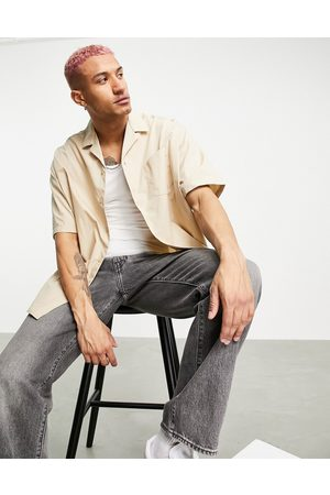 ASOS DESIGN Homem Casual - Extreme oversized shirt with half sleeve in stone-Neutral