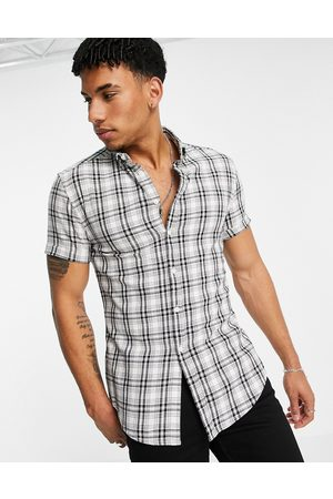 ASOS DESIGN Stretch skinny fit check shirt in white