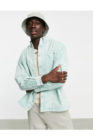 ASOS Boxy oversized shirt with bleach wash in sage green