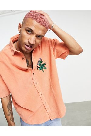 ASOS Homem Casual - Actual 90s boxy oversized chunky cord shirt with floral embroidery-Orange
