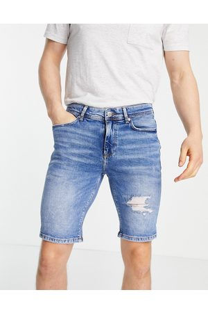 River Island Skinny denim shorts with rips in blue