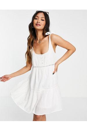 ASOS DESIGN Tie shoulder lace insert smock mini sundress in white