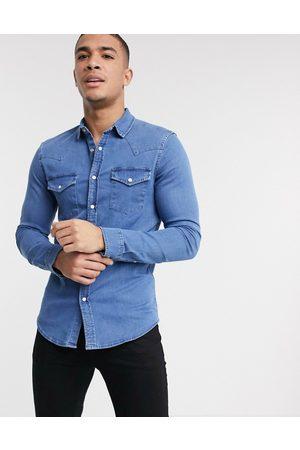 ASOS DESIGN Skinny fit western denim shirt in mid wash-Blue