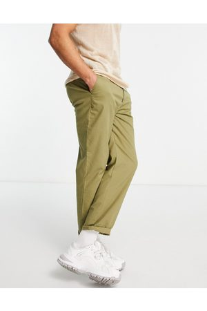 ASOS Relaxed skater chino trousers in light green