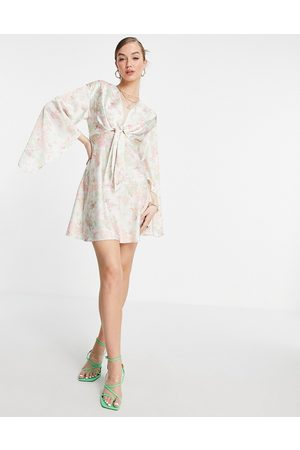 ASOS DESIGN Cape sleeve satin mini dress with knot front in cream floral-White