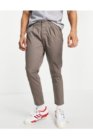 ASOS DESIGN Cigarette chinos with pleats brown