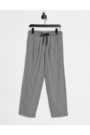 ASOS DESIGN Wide leg trousers in micro check-Black