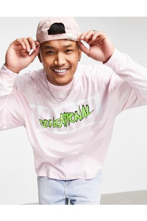 ASOS DESIGN Oversized long sleeve t-shirt with She Hulk print in pink