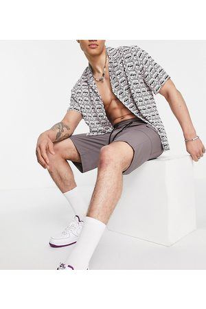 COLLUSION Cargo shorts with pockets in dark purple