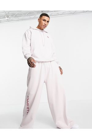 ASOS Unrvlld Supply ASOS Unrvlld Spply co-ord extreme oversized jogger with seam details & leg logo print in lilac-Purple