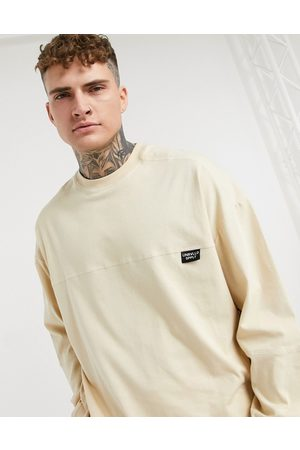 ASOS Unrvlld Supply ASOS Unrvlld Spply long sleeve oversized t-shirt with seam detail in beige-Neutral