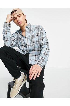ASOS DESIGN Homem Casual - 90s oversized shirt in blue tartan check