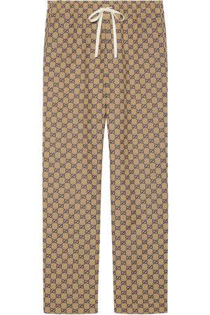 Gucci Homem Calças - Monogram-print drawstring trousers