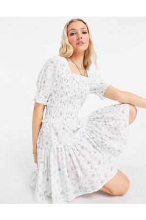 ASOS DESIGN Square neck shirred raw edge mini skater dress in white based floral print-Multi