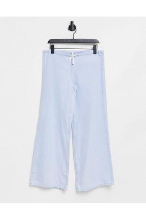 Weekday Breeze organic cotton wide leg lightweight denim trousers with tie waist in bleach wash-Blue